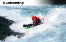 Whitewater riverboarding on the Kananaskis river in the Canadian Rockies